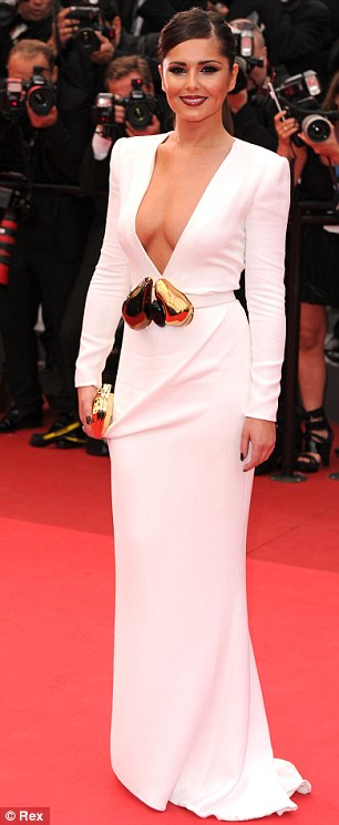 Revealing: The dress left very little to the imagination, but Cheryl succeeded in looking sexy and elegant
