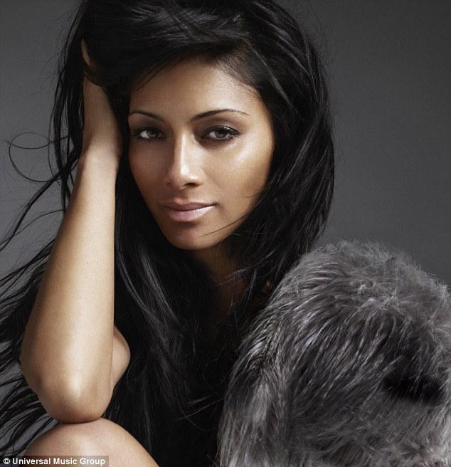 Close up: Scherzinger chose a close up of her face for the album cover of Killer Love - alongside a grey husky coat