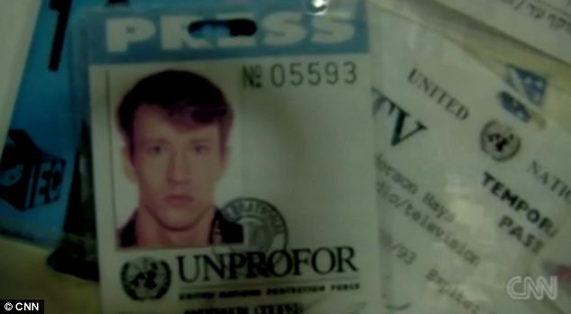 Younger days: Anderson Cooper as a young man, shown on an old press pass now hanging in his office