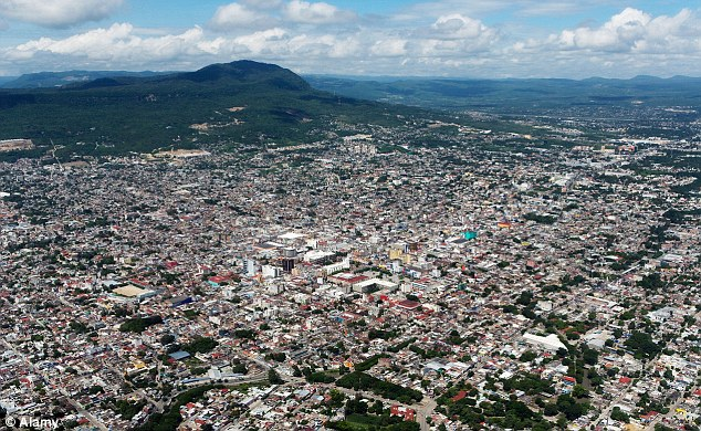 Detained: The immigrants are being held in Tuxtla, Chiapas state, as they receive humanitarian aid
