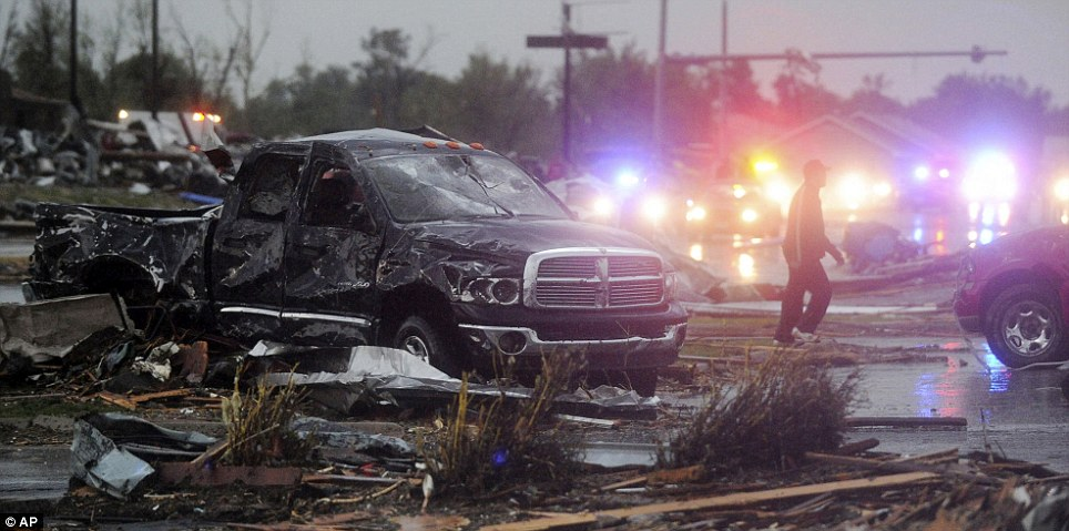 Carnage: Rescue vehicles line up along northbound Rangeline Road in Joplin, Mo. after a fatal tornado swept through the city