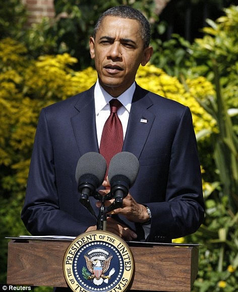 'Heartbreaking': Barack Obama speaking in London today vowed to visit Missouri on Sunday