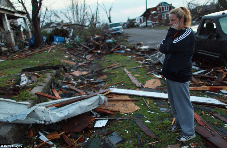 Lost: Carra Reed looks at a friends home that was destroyed when the massive tornado passed through Joplin, Missouri