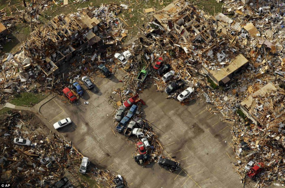 Chaos: A destroyed apartment complex is seen in an aerial view over Joplin