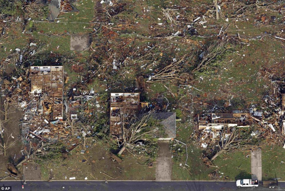 From the sky: Uprooted trees and building without roofs lie devastated in Joplin, Missouri after the tornado hit on Sunday