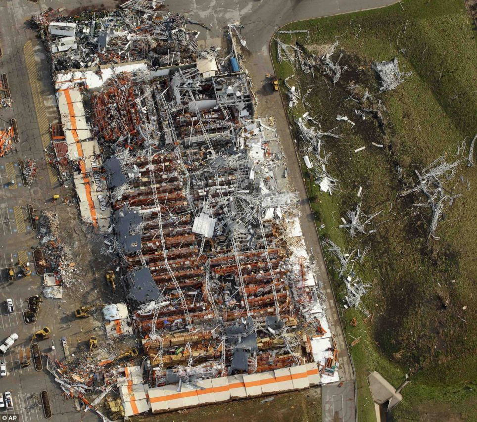 Destroyed: This incredible aerial image reveals how the tornado tore off the roof of Joplin's Home Depot
