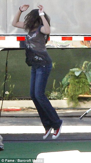 Look, I can whip my hair back and forth too! Paris jumped around on set