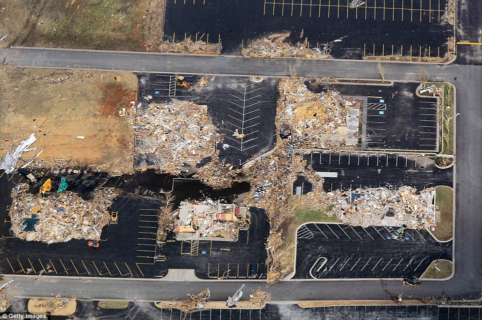 Flattened: Damage is seen a day after the tornado tore through Joplin killing at least 122 people in Joplin, a town of about 50,000