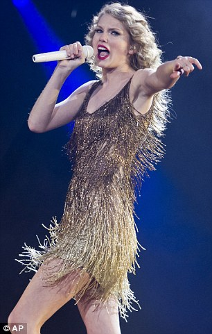 Taylor Swift Glitters In A Shimmering Fringed Dress And