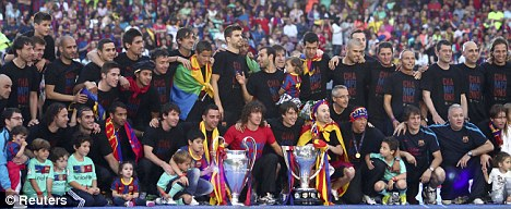 Celebration: Barcelona's players pose with the Champions League and Spanish league first division trophies