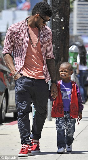 Daddy cool: Usher and his mini me both looked stylish in their colourful outfits