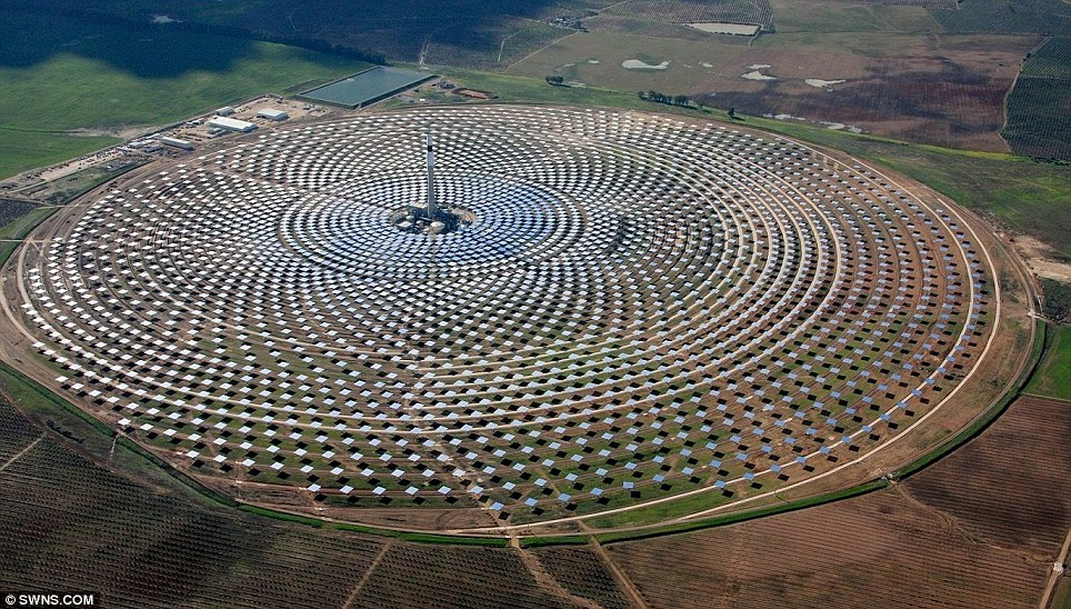 It lives by night: The Gemasolar solar power station near Seville has an incredible 2,650 panels spread across 185 hectares of rural land