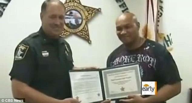 Courage: The 34-year-old was rewarded for his bravery by the Sarasota sheriff's office