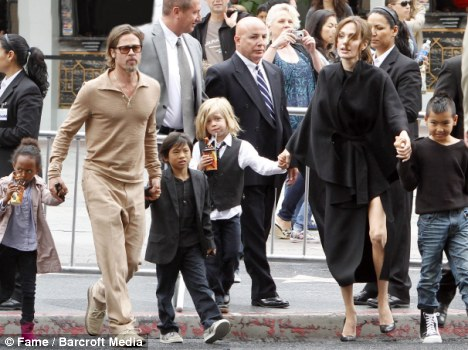 Family comes first: Angelina Jolie [pictured here with Brad Pitt, and children Zahara, Pax, Shiloh and Maddox] arrived en masse to the Kung Fu Panda 2 premiere in Los Angeles on May 22
