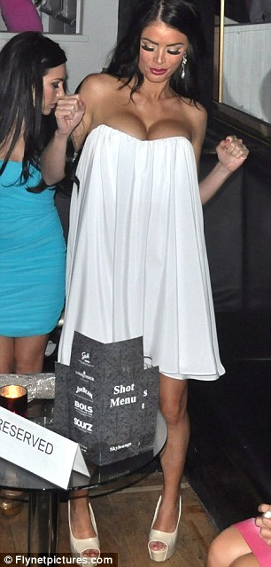 How is that staying up? The Only Way Is Essex star Chloe Sims wore an extremely low cut strapless white dress last night at Sky Lounge in Southport