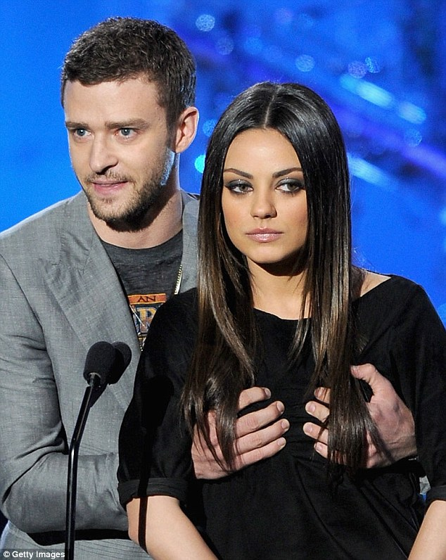 Hands on: Justin grabbed onto Mila's breasts in a move that once again drew gasps and laughs from the audience