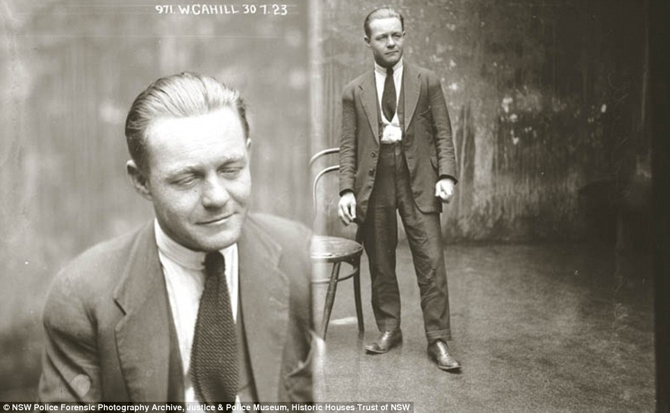 Strike a pose: William Cahill stands with a far away look in his eyes and a hint of a smirk in this photograph on July 30, 1923. Details of his crime are unknown