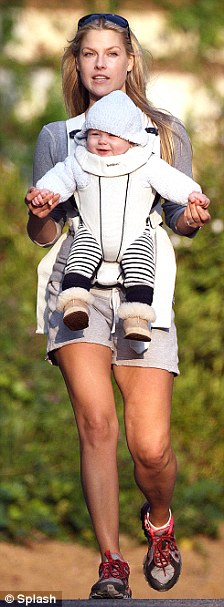 Novel: Ali Larter strapped on her five-month-old baby Theo on her chest and took him hiking with her to Runyon Canyon in Los Angeles yesterday