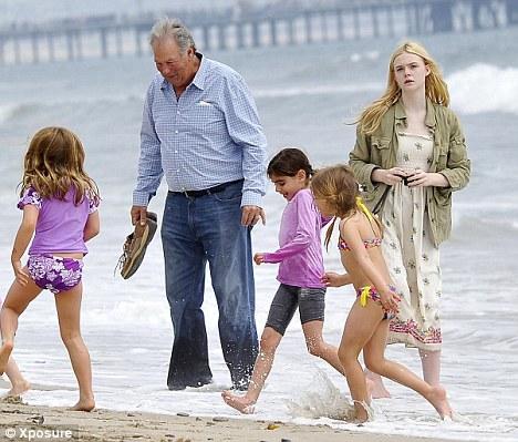 Dakota Fanning and sister Elle have a blast at LA beach ...