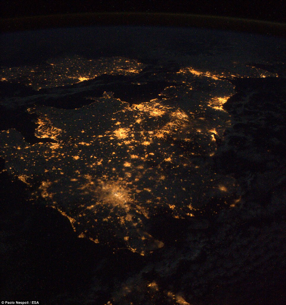 Britain by night: Italian astronaut Paolo Nespoili took this photo on a clear night while orbiting 230miles above Earth aboard the International Space Station