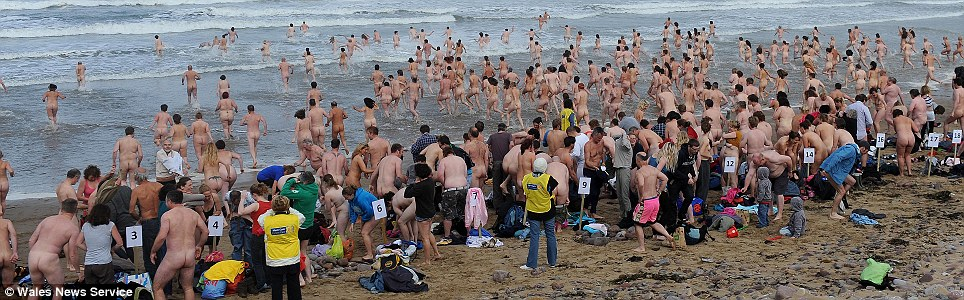 Ready, set, strip: Nudists strip off despite wet and windy conditions and appeared to be having great fun