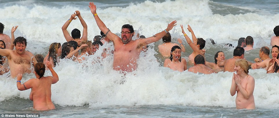 An eyeful: Skinny dippers jumped the waves in Wales as they celebrated their record-breaking achievement