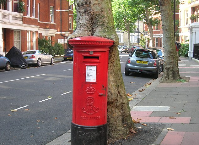 Yummy: A British plane tree is slowly eating a post box in West Kensington, London