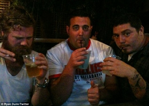 Last picture: Just hours before his death, Ryan (left) tweeted this photograph of him enjoying a night out with friends. It is not clear whether one of the other two men pictured was his male passenger
