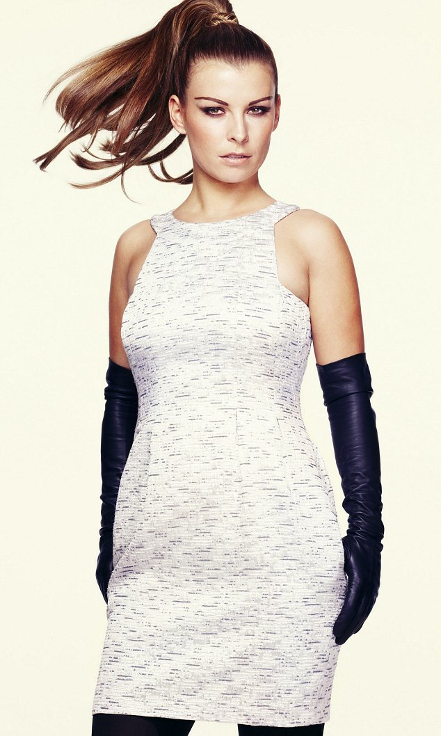 Spy chic: Coleen Rooney, 25 modelling her new range for Littlewoods.com looks like a new woman