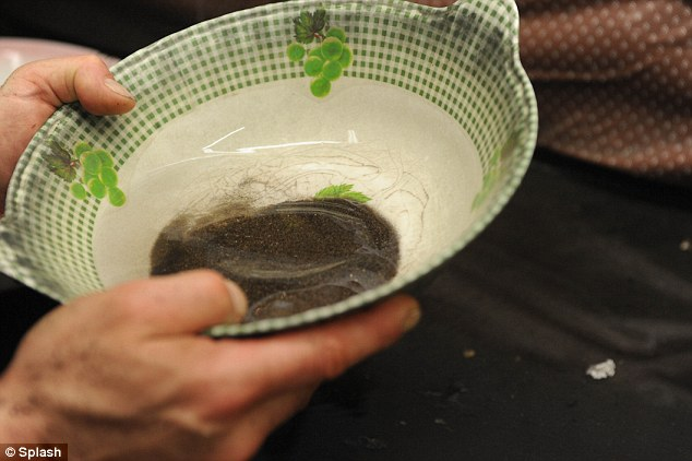 Lucky find: He then takes his findings to a nearby polishing studio where he pans away the dirt using a bowl and sieve
