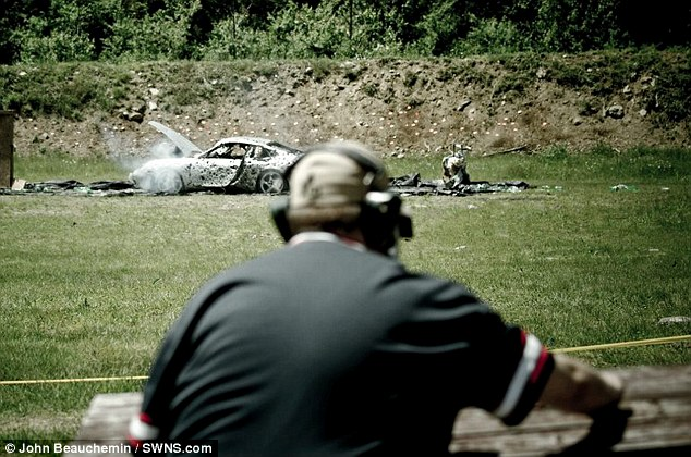 No mercy: Men, women and children fired off more than 10,000 rounds using machine guns and automatic weapons to leave the Porsche a bullet-riddled shadow of its former self