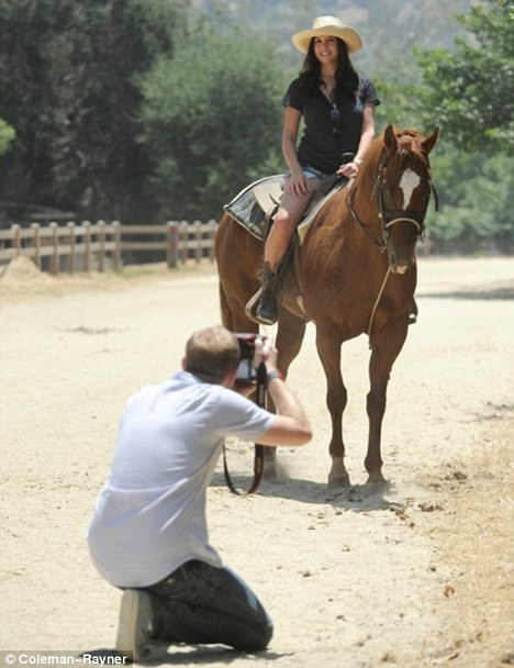 In the saddle: The star was taking part in a photo shoot in the Californian sun
