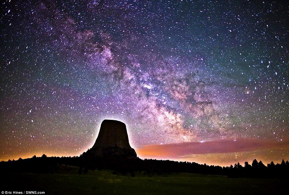 Crystal clear night: Amateur photographer Eric Hines' incredible image captures the Milky Way in all its glory above the haloed Devil's Tower landmark in Wyoming