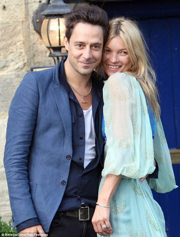 We're getting married the morning: A beaming Kate Moss snuggles up to her future husband Jamie Hince outside The Swan pub in Southrop in the Cotswolds