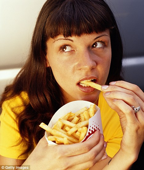 Finger-lickin' good: Cannabis-like chemicals in the body called endocannabinoids are the reason we find it so difficult to walk away from chips and crisps