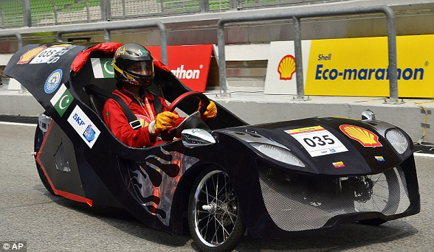 Behind the wheel: A racer from Pakistan shows off his sleek motor during the Shell Eco-marathon