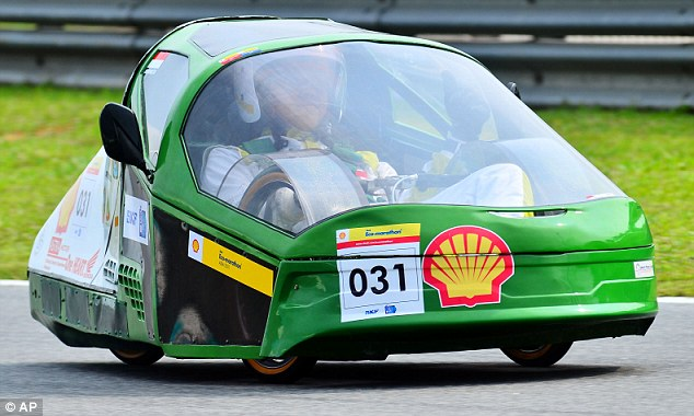 Green power: A driver from the Polytechnic State of Pontianak in Indonesia just fits inside his team's innovative design