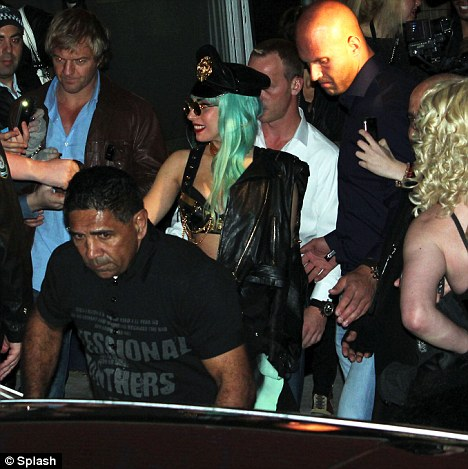 Mobbed: Lady Gaga got swarmed by fans as she left a nightclub in Sydney, Australia last night