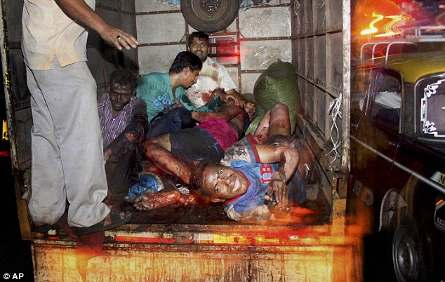 Hurt: Injured victims of the Mumbai balsts today are loaded onto a truck to be taken to hospital