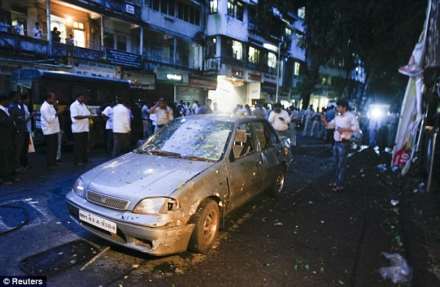 Smashed: A damaged car in the Dadar area of Mumbai - one of three districts hit by the blasts