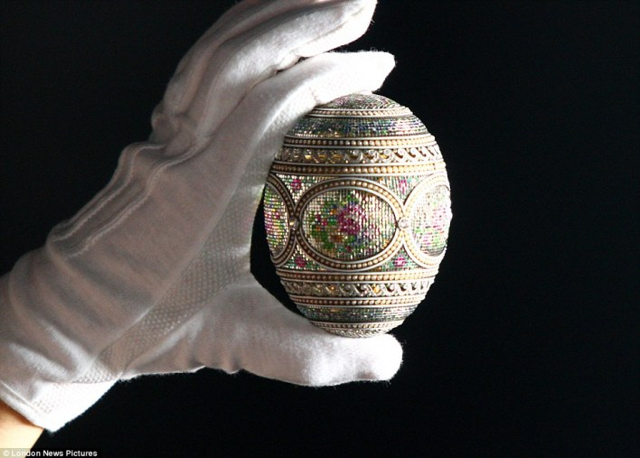 Glitter ball: A specialist handles a mosaic egg which forms part of a display at the Summer Opening of Buckingham Palace where over 100 Faberge pieces will be exhibited