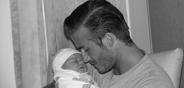 Daddy's little girl: Victoria Beckham has posted the first picture of husband David with their new daughter Harper Seven