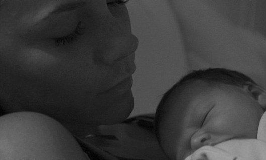 Having a nap: David later posted a picture of Victoria with Harper on his Facebook page