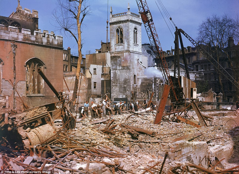 Wreckage: A construction crew carries out the task of completing the demolition of a site largely destroyed in an air raid