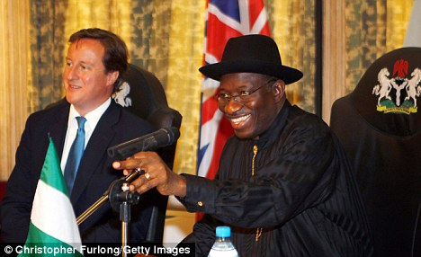 Tour: David Cameron and Nigerian president Goodluck Jonathan as they take part in round table talks at the State House in Lagos  Read more: http://www.dailymail.co.uk/news/article-2016677/Cameron-warns-Africans-Chinese-invasion-pour-billions-continent.html#ixzz1TFeZeTDu