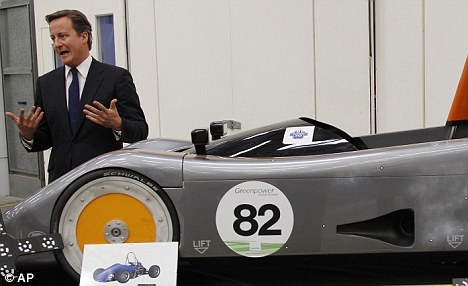 David Cameron with an experimental car built by apprentices at Jaguar Land Rover's research and development and corporate headquarters in Gaydon