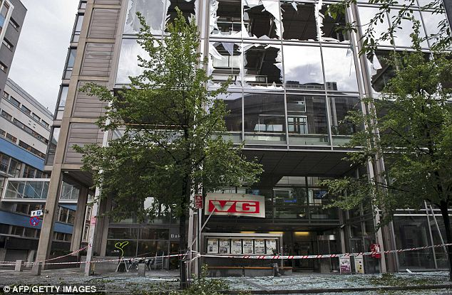 This image shows the damages at the entrance of the building housing the Norwegian newspaper VG
