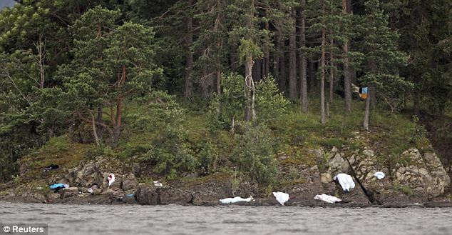 White sheets cover the corpses of teenagers shot on the shore of the small, wooded island