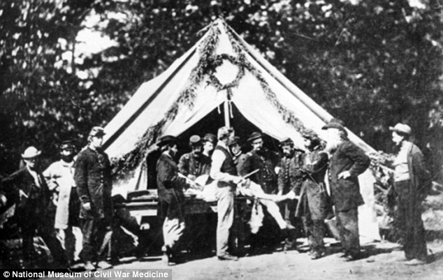 In this July 1863 photo, an amputation is being performed in front of a hospital tent in Gettysburg