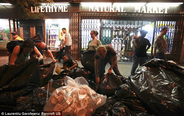Freegans in New York gather their findings before lighting the barbecue